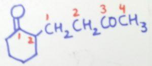 2-(3-oxobutyl)cyclohexane-1-one